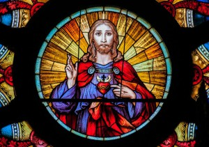 Sacred Heart at the centre of a rose window